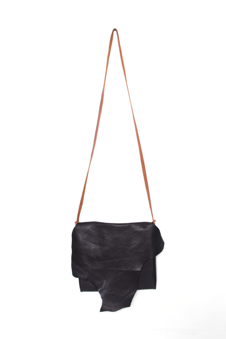 Clarita Black Leather Raw Sling Bag by Liana Rosa