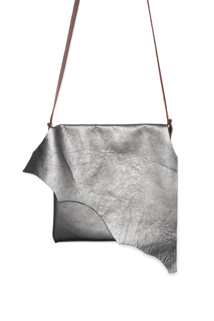 Clarita Metallic Grey Leather Raw Sling Bag Close Up View by Liana Rosa