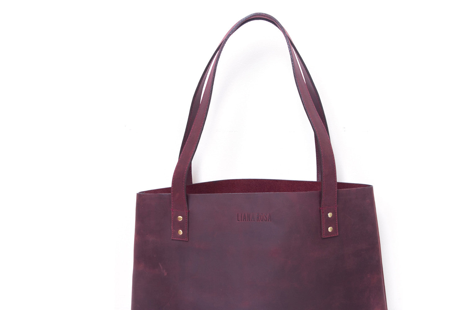 Henry Sangria Burgundy Leather Tote Bag Close Up View by Liana Rosa