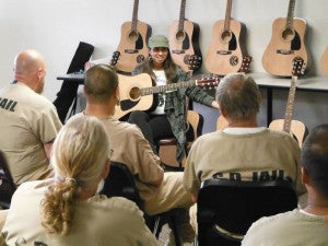 Farayi Dominique sharing with the inmates at Costa Mesa Correctional Facility before the launch of their music program through Jail Guitar Doors. (Image and caption courtesy of Jail Guitar Doors Facebook page)