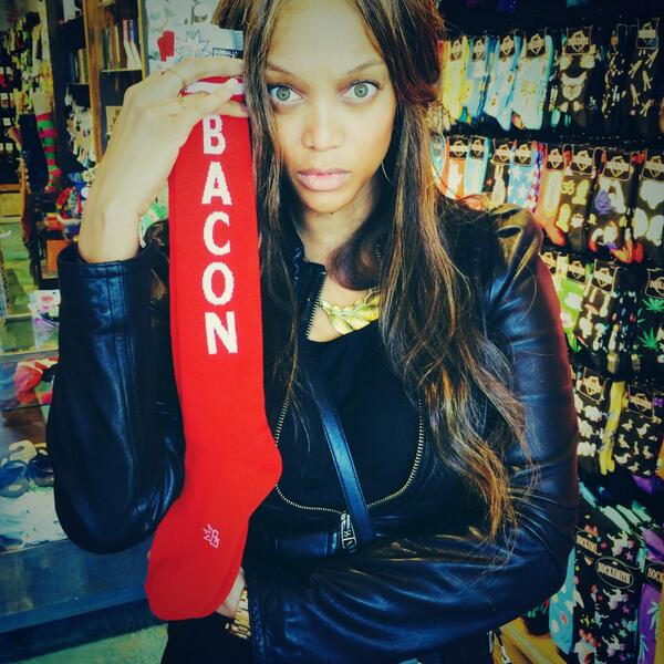 Tyra Banks showing off her Gumball Poodle BACON socks!