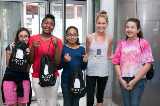 Rena alongside some happy campers at the Lower Eastside Girls Club of New York. Each girl received a GoodyBag compiled specifically for summer camp.