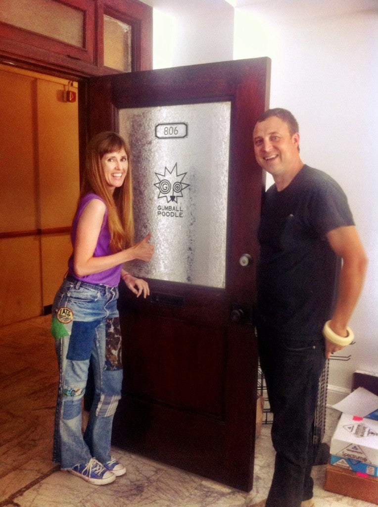 Erica and Dan admiring our new door signage!