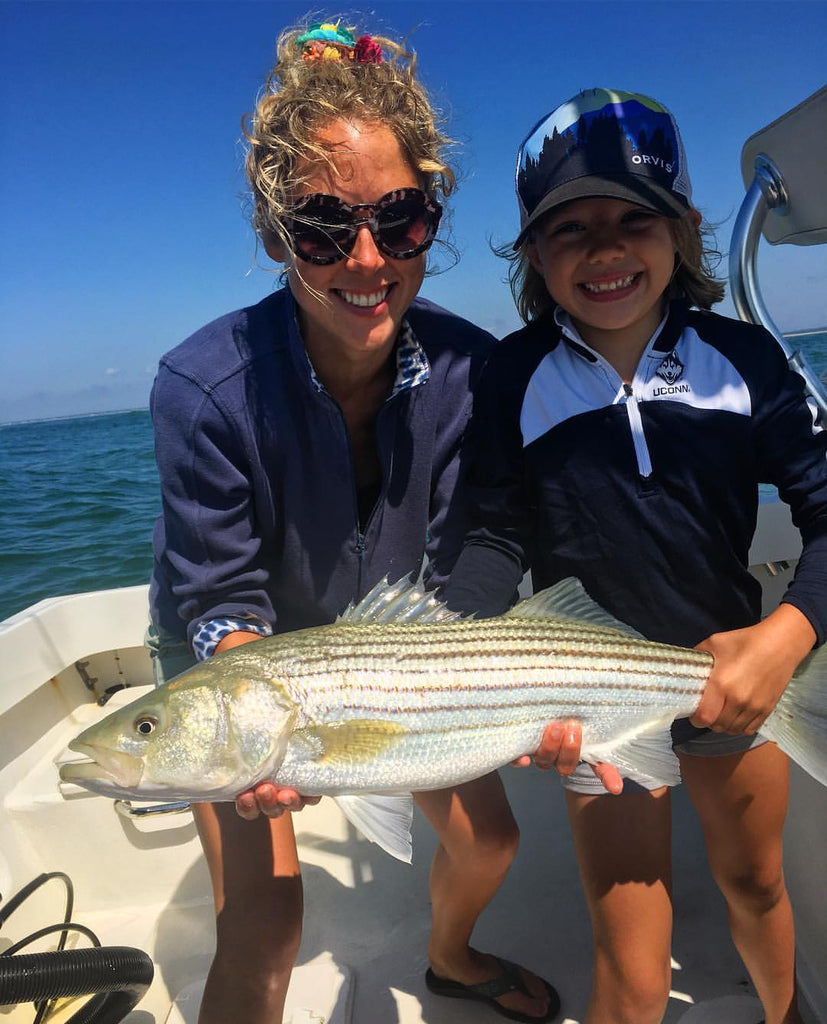 Abbie and her young client hooked into this Martha's Vineyard striper.