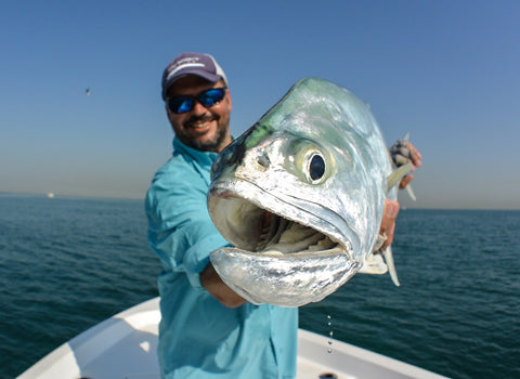 Nick Bowles T&T Ambassador holds a big queenfish caught in Dubai.