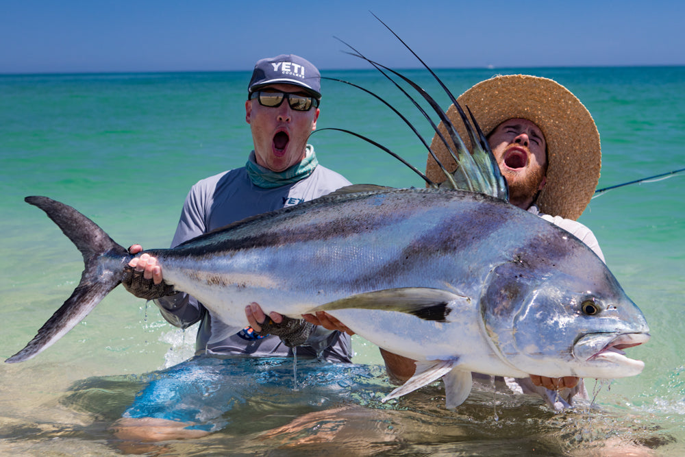 Thomas & Thomas fly fishing ambassador Christiaan Pretorius and Thomas & Thomas advisor Jako Lucas with a massive rooster fish.
