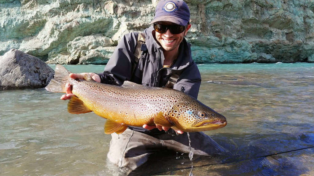 Joe Goodspeed with a large brightly colored Chilean brown trout.
