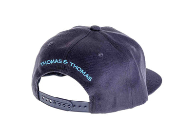 "Thomas and Thomas flat brim hat with embroidered ""Thomas & Thomas"" on back."