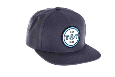 Thomas and Thomas flat brim badge hat with snapback closure.