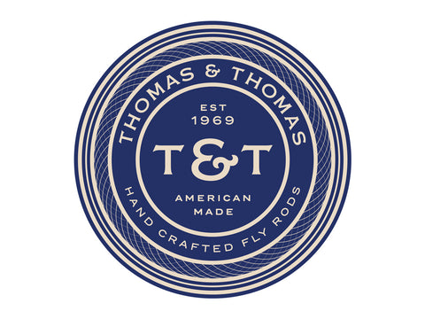 Thomas and Thomas round blue and white decal.