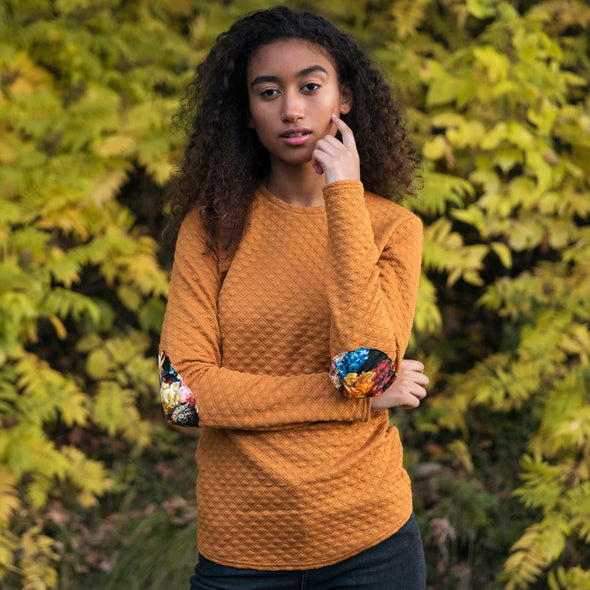 mustard fitted sweatshirt, with faux leather floral elbow patches