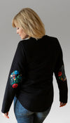 fitted black sweater with floral faux leather elbow patches, crewneck, hem is longer at the back, made in canada, poly cotton spandex fabric