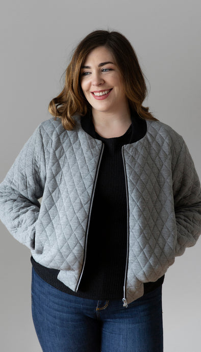 light grey quilted cotton bomber jacket, with black ribbing, pockets and unique black lining, handmade in Canada
