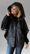 black wool poncho, matching pockets, oversized hood and has cuffed sleeves, handmade in Canada