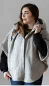 light grey/silver oversized poncho, it has an oversized hood, pockets and is a laying piece, handmade in Toronto