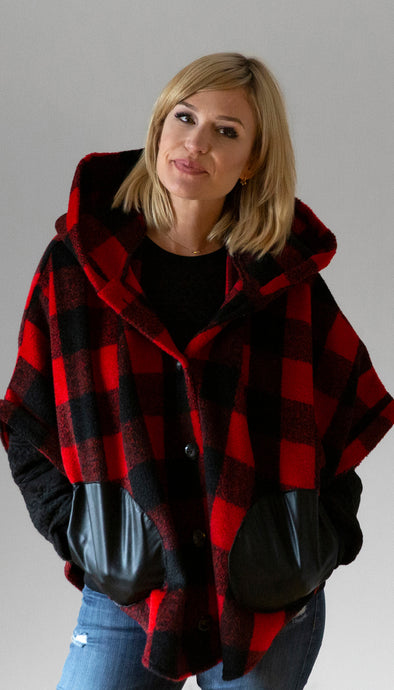 red lumberjack plaid poncho with black faux leather pockets, big hood, button closures, handmade in Canada