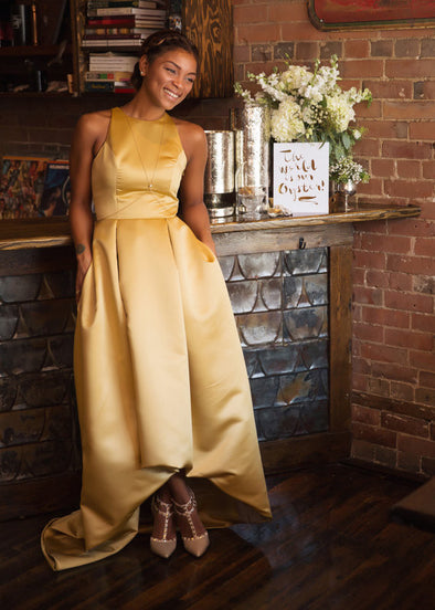 pleated gold satin gown with high low hem and pockets custom made in Toronto