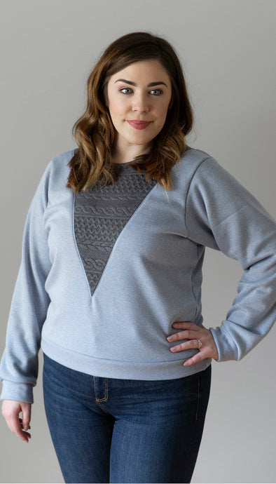 light blue sweater with grey cable knit v-neck insert handmade in Ottawa