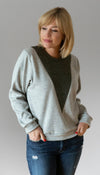 light grey long sleeve sweater with v-insert detail, insert fabric is olive cable knit fabric, handmade in ottawa