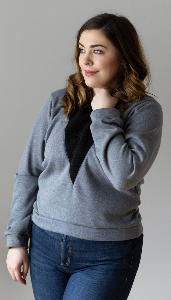 steel blue long sleeve sweater with v-insert that is black cable knit fabric, same detail is the in the back, made in toronto