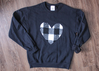 black athletic sweater with white and black checked heart, heart sweater, winter cozy sweater, recycled fabric, handmade in Ottawa