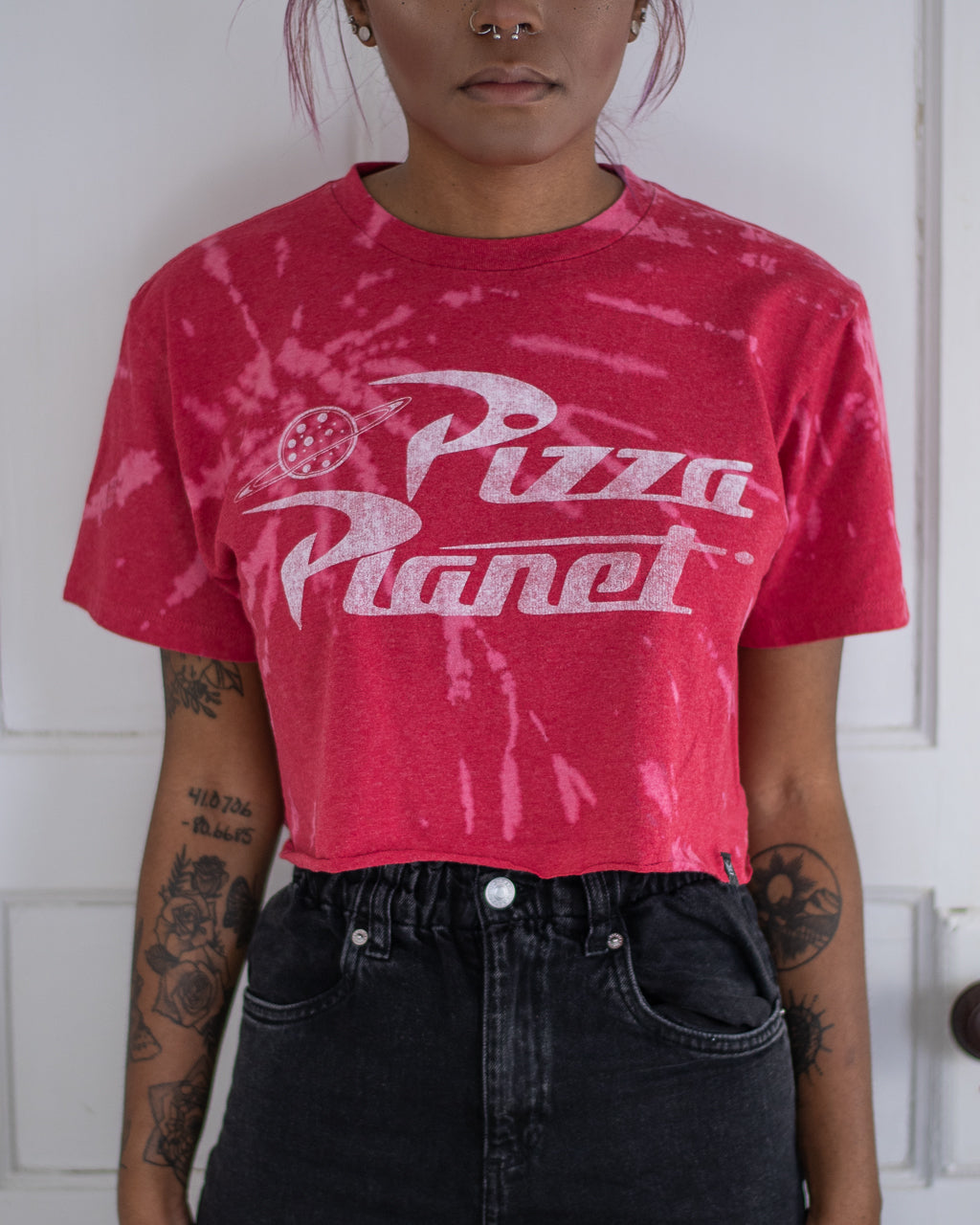 Pizza Planet red bleach dye crop tee