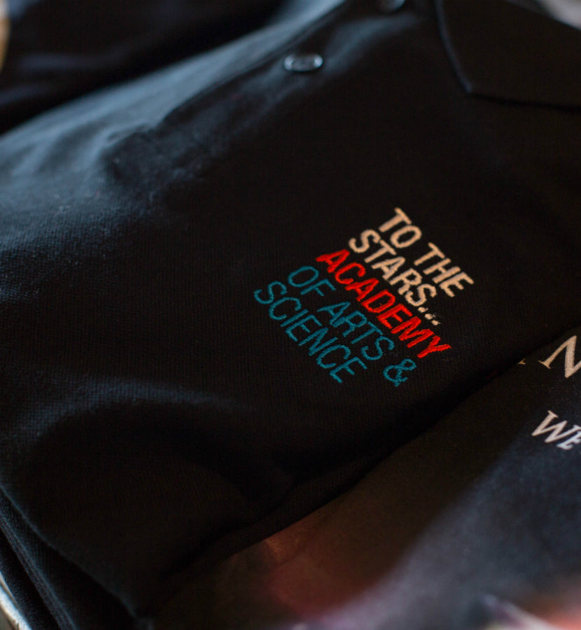 To The Stars... Academy Of Arts & Science Text Logo Polo Black - retail - To The Stars...