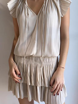 NUDE MINI DRESS WITH PLEATED SKIRT