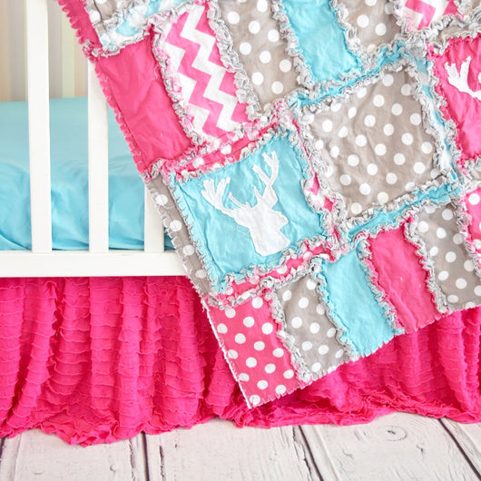 Flamingo mini crib quilt in these colors and purple with white crib skirt and flamingo sheet
