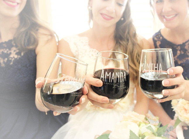 Bride and Bridesmaid with wine glasses, engraved stemless glasses, personalized bridesmaid glasses, stemless wine glasses, personalize wedding glasses, bridesmaid wine glasses, ScisorMill.com, bride getting ready, cheap bridesmaid gifts