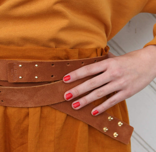 burgundy red leather belt with silver studs closer