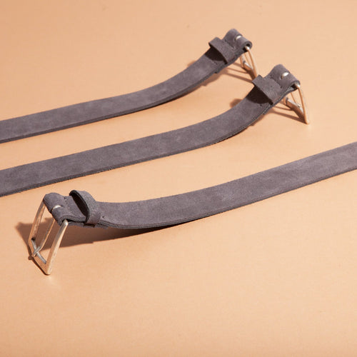 sued grey leather belt with a silver buckle