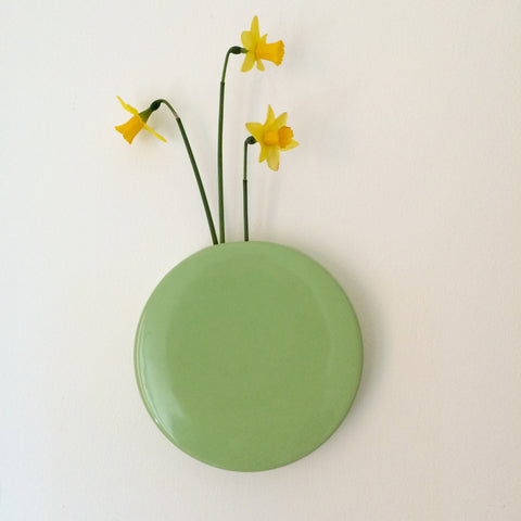 Add flowers to your ceramic wall dot vase