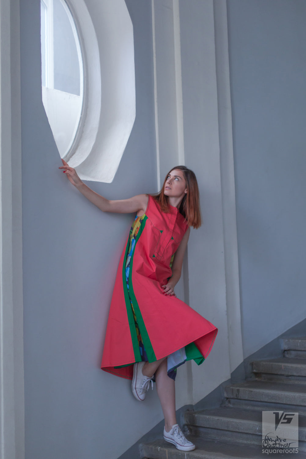 "Long avant-garde long geometric dress ""Cosmic tetris"" model ""Orange Green"" Designer dresses for creative women by Squareroot5 wear . Architectural Institute shot. Interior"