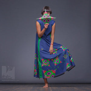 Bright, geometrical aesthetic dress with short sleeves. Dark-blue and green.