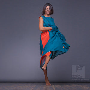 Experimental  turquoise and orange dress with big side pockets and geometrical pattern.