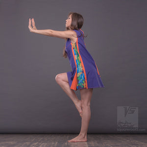 Bright, geometrical aesthetic dress with short sleeves. Violet and orange.
