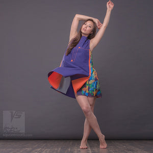 Experimental festival design purple-orange dress with geometric pattern.