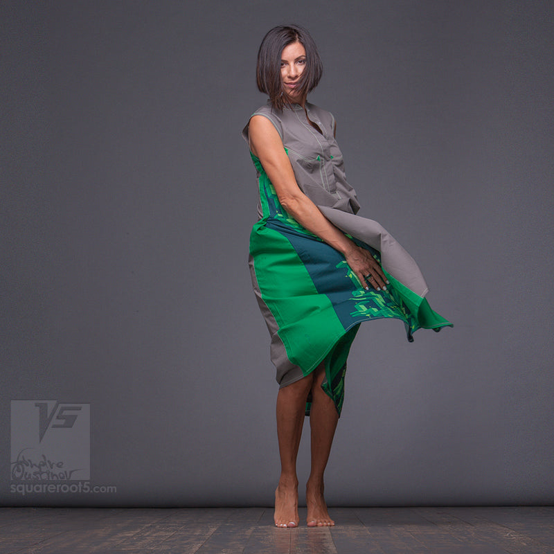 Long grey-green dress with Asymmetrical aesthetic.