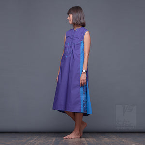 Experimental violet dress with geometrical pattern.