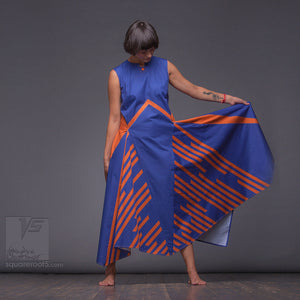 Long avant-garde dress with a geometric eccentric design. Experimental festival design with geometric pattern.