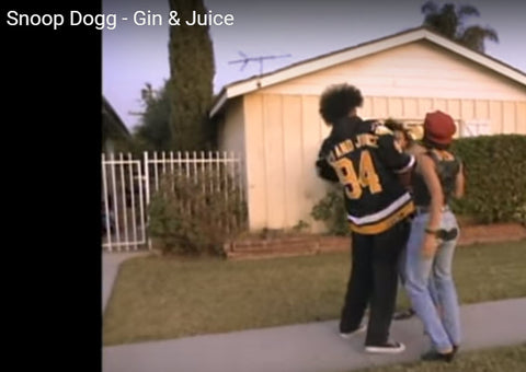 Snoop Dogg wearing a pair of Chucks in his Gin & Juice Music Video