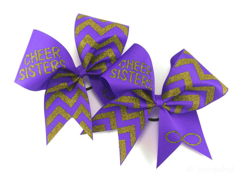 Cheer sisters cheer bows with turquoise ribbon and silver glitter design. Price is for 2 bows. - BRAGABIT  - 1