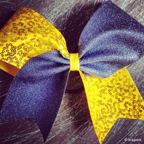 Navy glitter and yellow sequins cheer bow. - BRAGABIT