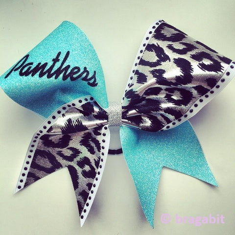 Panthers cheer bow with light turquoise glitter, cheetah print fabric and black rhinestones. Other color combinations are available, you can put your name or logo on it. - BRAGABIT