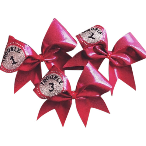 Pink mystique fabric trouble 1,2,3 cheer bow with rhinestones. - BRAGABIT