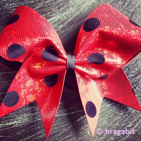 Red cheer bow with black dots. - BRAGABIT