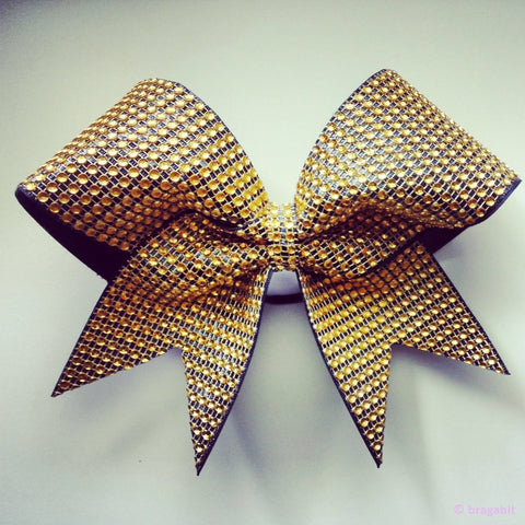 Rhinestone material in gold and black ribbon cheer bow. - BRAGABIT