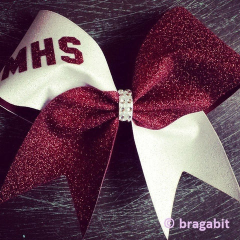 Two color glitter bow. Maroon and white glitter cheer bow with rhinestone material center. - BRAGABIT