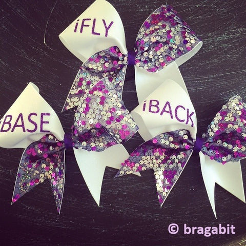 White and sequin fabric with iFly, iBase, iBack etc. IF YOU NEED MORE THAN ONE BOW LEAVE A NOTE WITH WHAT POSITION YOU NEED AND HOW MANY. EXAMPLE: IFLY-5,IBACK- 2, ICOACH - 3 etc - BRAGABIT
